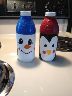 Christmas snowman and penguin I made out of glass snapple bottles :)