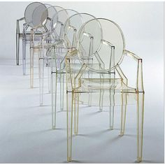 Louis Ghost Chair by Philippe Starck, 2002 for Kartell: Made in Italy of polycarbonate, this iconic chair has an ergonomic design, aesthetic flexibility, is light weight, yet sturdy and stackable up to 6 high.
