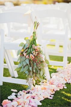 Rose petals and hanging floral aisle decor. Captured By: Elyse Hall Photography ---> http://www.weddingchicks.com/2014/06/02/desert-wedding/