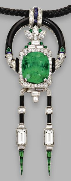 Emerald, diamond, onyx and sapphire pendant-necklace, Mauboussin, circa 1925.    The pendant set with a cushion-shaped emerald weighing 25.50 carats, framed by calibré-cut emeralds and old European-cut, pear-shaped, marquise-shaped and baguette diamonds, anchored by 2 articulated fringes set with emerald-cut and baguette diamonds, calibré-cut emeralds and onyx segments, accented with old European-cut diamonds, sapphires and emeralds, total diamond weight approx 13.95 carats. Via Sotheby's.