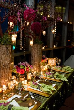 love these forest inspired centerpieces with their pops of color and sparkle