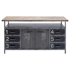 Industrial-style wood and metal cabinet with 6 stencil-numbered drawers.      Product: CabinetConstruction Material: