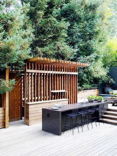 The Most Amazing Outdoor Kitchens// streamlined outdoor space, modern exterior, Bertoia counter stools