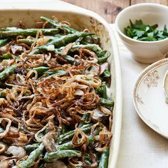 Creamy Green Beans with Crispy Shallots - yum!! Is it Thanksgiving yet??  More easy Thanksgiving Recipes: http://www.bhg.com/thanksgiving/recipes/shortcut-thanksgiving-recipes-from-sara-foster/