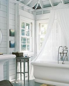 So pretty, light and bright white with a mosquito net over the bath.  Vintage chic bathroom