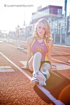 "high school track team senior portraits - love the idea of getting a shot on their ""playing field"""
