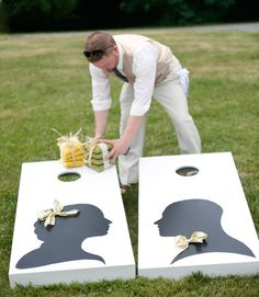 This wedding game is personalized for the bride and groom! Silhouettes are displayed on the cornhole boards, and the games are set up for guests