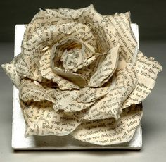 paper rose from old book page.