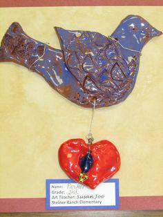 American Folk art terra cotta bird sculpture by my 2nd grade student; lesson by art teacher: Susan Joe