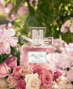 a shot of your wedding day perfume with some flowers from the wedding.