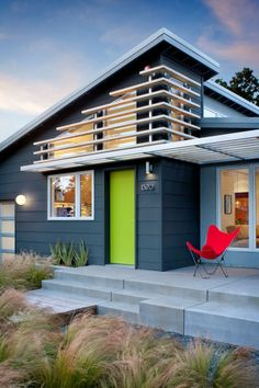 Modern home entrance. Bright green door.