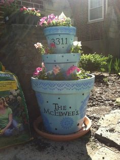 Stacked flower pots for the front of the house! :) mrskrit