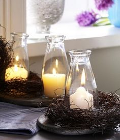 Simple nests and candles in bottles