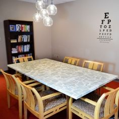 See how to cover a dingy old table in book pages with Mod Podge! Perfect project for any old table