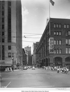 Petticoat Lane - View of 11th Street or Petticoat Lane looking toward the west at the Grand Avenue intersection in downtown Kansas City, Missouri. The Emery Bird Thayer store is in view on the northwest corner of 11th and Grand and Zales Jewelers is seen on the southwest corner. Macy's department store located on Main Street can be seen at the end of 11th Street.    1950 petticoat lane
