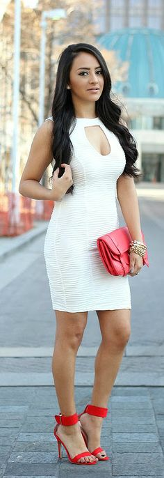 Great looking little white cut out dress.