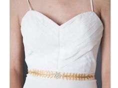 A gold belt is perfect for a fall wedding! | Fair Trade Ruffle Back Wedding Gown | Green Bride Guide