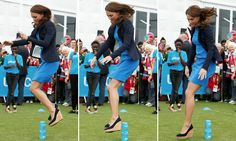 Kate Middleton jumps over cans in high-heeled wedges. Does not break ankle. All are shocked.