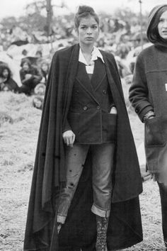 Bianca Jagger -- love the blazer, jeans and boots she's wearing.