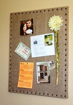 Re-fresh an old cork board by covering it in burlap with upholstery nails.