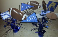 Inexpensive idea for sports banquet centerpieces.  Bought balloon weights from Dollar Store already decorated in cellophane and stars, added three heavy duty bamboo skewers to each using hot glue, and then glued on football-themed die cuts made on Cricut machine.  Was very time-consuming to cut all the layered die cuts using one machine but if you could get several machines going at once, it would go faster!  Silver balloon weights would work for color schemes without matching balloon weights.