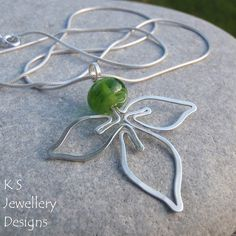 green trefoil pendant  green leaves earrings jewelrylessons.com