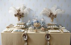 Love the #feather arrangement on this #dessert table