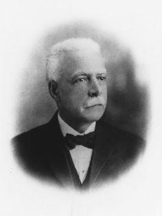 This 1930 Scurlock portrait of activist Archibald Grimké shows the distinguished man with a trim mustache.