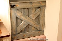 Barn Door Baby Gate for Stairs by @Remodelaholic