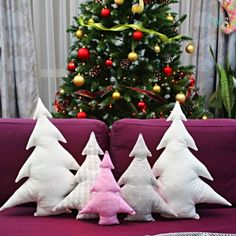 Have you been looking for cute ideas for Christmas pillows to make? A Christmas tree pillow (or a bunch of these cuties) is a fun and adorable addition to your holiday decor!  #easypeasycreativeideas #sew #sewing #christmas #christmascrafts #christmastree #holidaycrafts #sewingtutorials #sewingpattern #beginnersewing