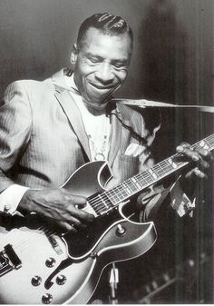 "Aaron Thibeaux ""T-Bone"" Walker 1910 –1975) was a critically acclaimed blues guitarist, singer, songwriter and multi-instrumentalist, who was one of the most influential pioneers and innovators of the jump blues and electric blues sound. He is the first musician recorded playing blues with the electric guitar. His stage act included playing his guitar behind his back and with his teeth. Things that Jimi Hendryx copied later on."
