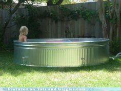 stock tank used as a back yard pool.