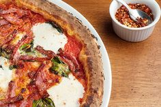 """The BEST Pizza In NYC #refinery29  http://www.refinery29.com/best-pizza#slide9  Zero Otto Nove: """"After a visit to the New York Botanical Gardens, head to this Arthur Avenue favorite for unmissable brick-oven pizza."""""""