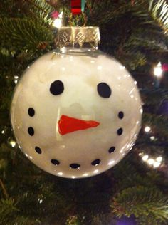Super Cute Hand Painted Snowman Glass Ornament . $5.00, via Etsy.