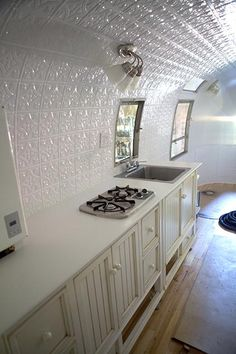 MaryJaneFarm - fabulous Airstream Restoration.  Love the cabinets!  Great restoration tips.