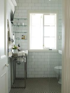White Tiled Bath Steel Sink Base/Remodelista