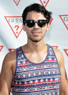 Joe Jonas  http://manhuntdaily.com/2013/10/the-jonas-brothers-have-split-up-none-of-em-came-out-yet/