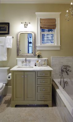 Great way to deal with an awkward window in this bathroom.  Urban Grace http://urbangraceinteriorsinc.com/#home/