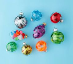 Fill plastic ornaments (available at craft stores) with ribbons, pom poms, garland, and more.