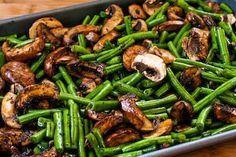 Yum!! Roasted green beans with mushrooms, balsamic, and Parmesan. Marinate in ziploc bag, spread out on cookie sheet and bake at 400, then sprinkle with Parmesan.