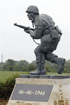 "Statue of Pennsylvania native Maj. Dick Winters, unveiled on Wednesday, June 6, 2012 near the beaches where the D-Day invasion of France began in 1944, one of many events marking the 68th anniversary of D-Day, the Allied operation that paved the way for the end of the war. The bronze statue built near the village of Sainte Marie du Mont, is a tribute to a man whose quiet leadership was chronicled in the book and television series ""Band of Brothers."" (AP Photo/Remy de la Mauviniere)"