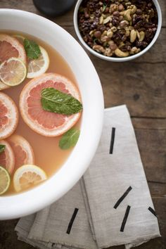 Bourbon Punch ⅓ cup water ⅓ cup sugar 15 fresh mint sprigs, divided 4 cups strained fresh pink grapefruit juice 2½ cups bourbon 12 dashes aromatic bitters 1 cup club soda garnishes: grapefruit, lemon, lime ice  See the full recipe at http://domino.com/throw-a-cocktail-party-in-under-an-hour