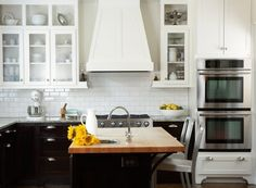 black & white kitchen with butcher block island countertop