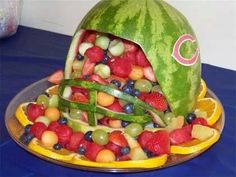 Football party idea-fruit in helmet carved from watermelon. #DIY #FootballParty #ideas