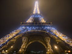 Looking Up at Eiffel Tower in Fog and Rain at Night, Paris, France Photographic Print