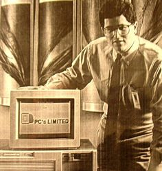 Michael Dell with an early model of a Dell computer.