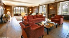 Panelling: The living room contains wood panels in the Tudor style of its former royal owners
