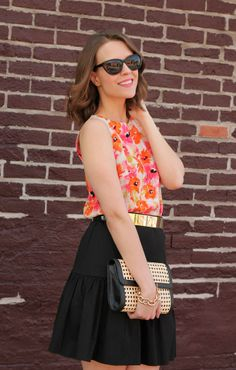 Add energy to a black skirt by pairing it with a flirty floral top.