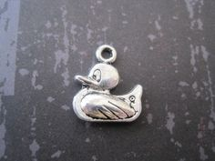 Set of 8 double sided antique silver duck charms. $2.50, via Etsy.