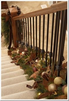 Style your stairway with beautifully decorated garland at the base around the spindles instead of the normal railing dressing.  The result is stunning and you can actually hold onto the railing while on the stairs.